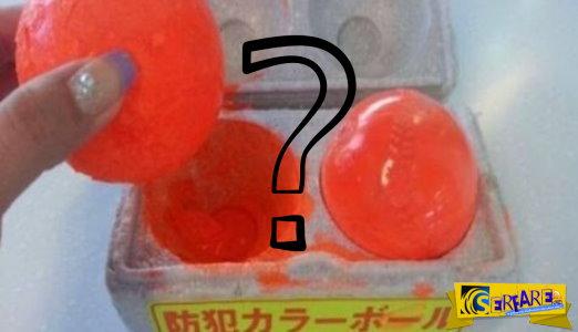 Μπορείς να μαντέψεις τί ακριβώς κάνουν αυτές εδώ οι πορτοκαλί μπάλες;