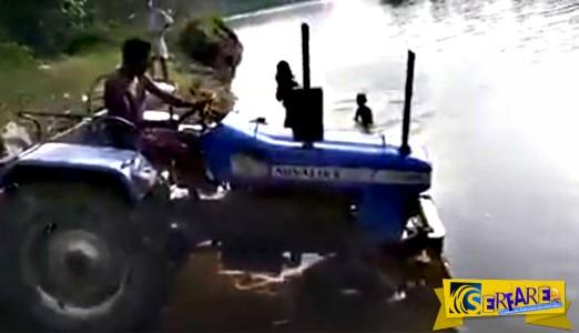 Ούτε το ποτάμι δεν εμποδίζει αυτόν τον αγρότη από το να κάνει τη δουλειά του!